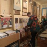 Student Jack Leiper looking through rows of records and Paradise Bound.