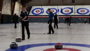 Alex Champ (left) curling with the Ryerson team.