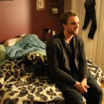 Ryerson University graduate Kyle Cunningham in his bedroom at his parent's house.