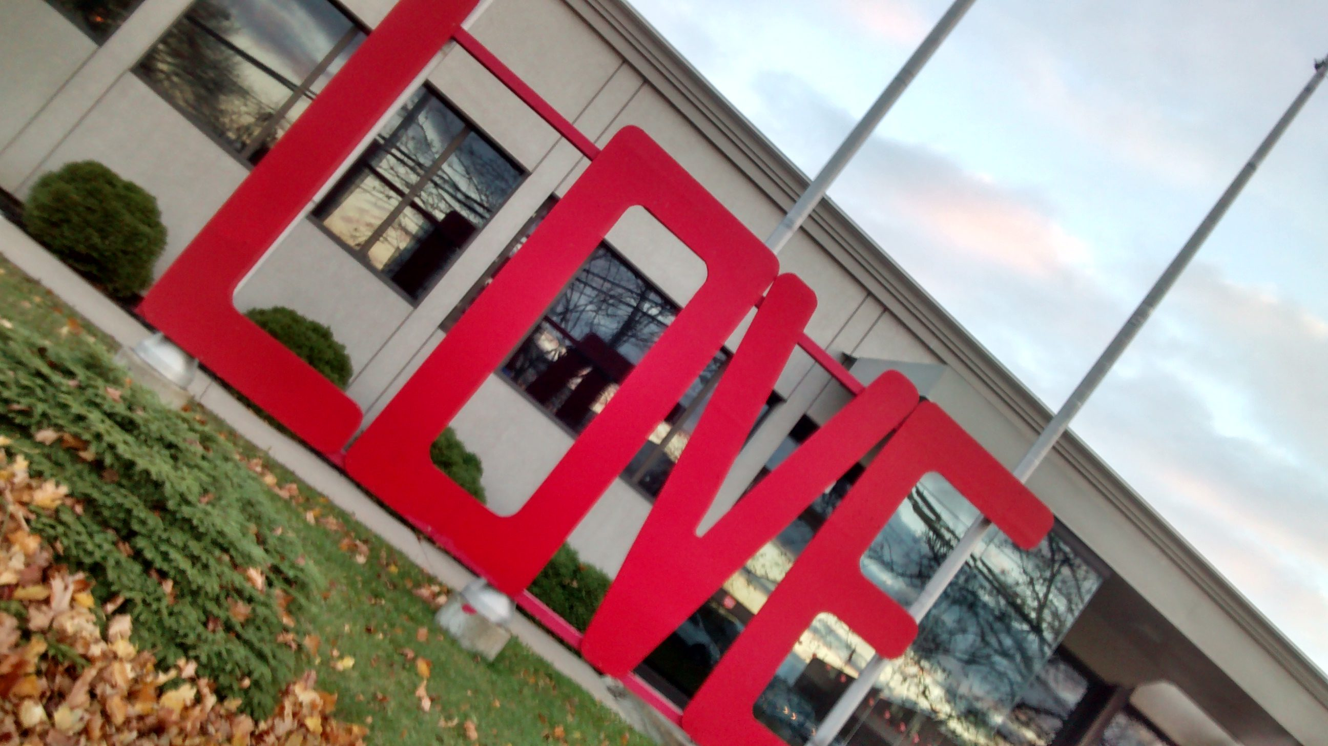 "Large red ""LOVE"" sign in front of building."