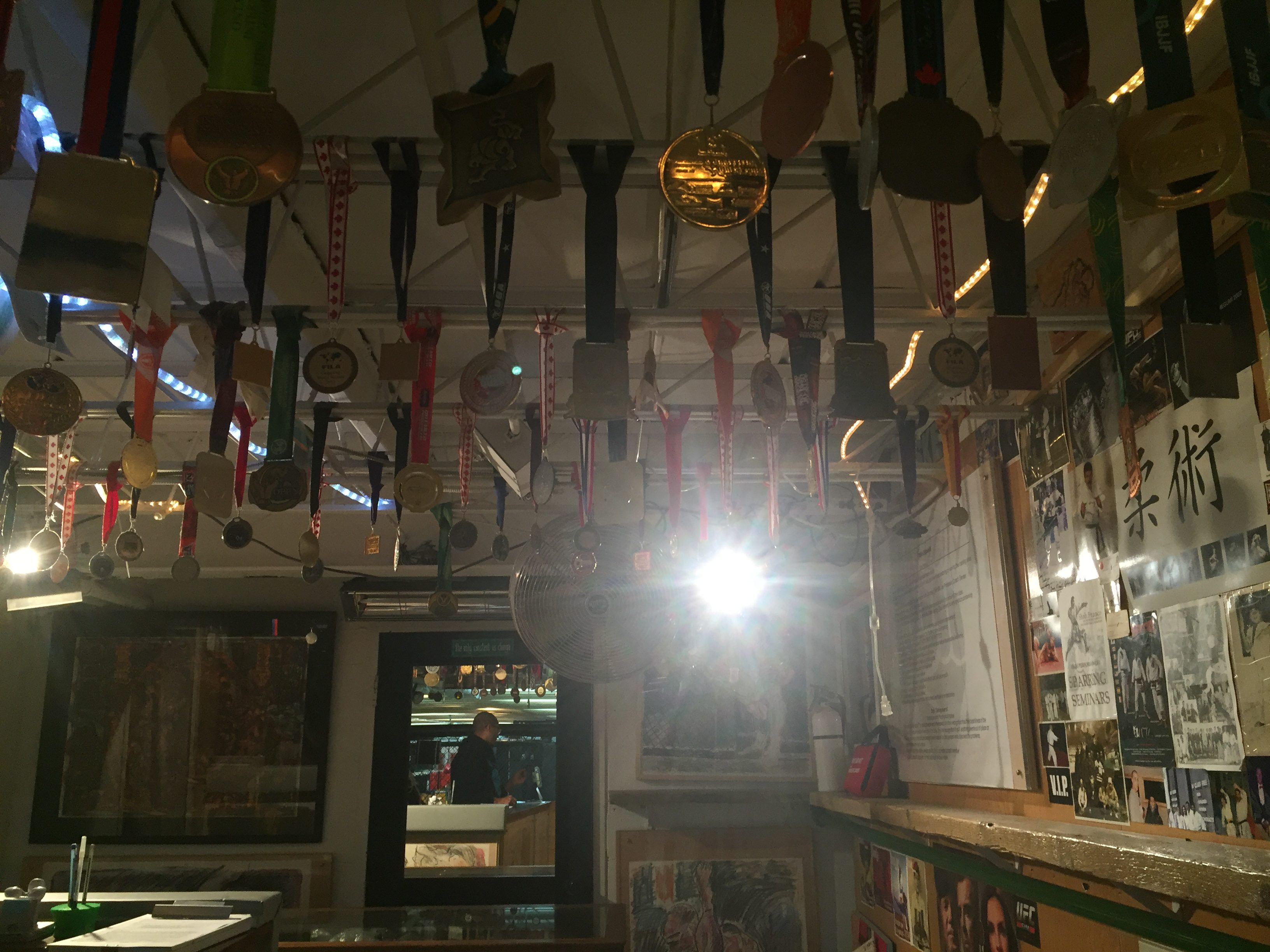 Room with various rows of medals hanging from ceiling.