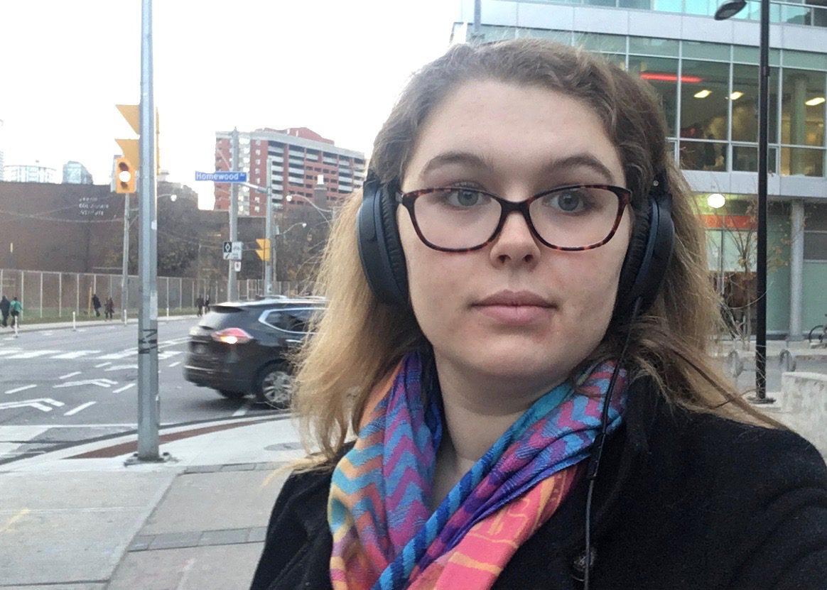 Selfie of woman wearing headphones.