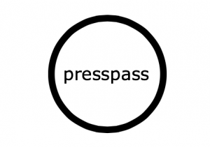 """Presspass"" written in black surrounded by black circle."