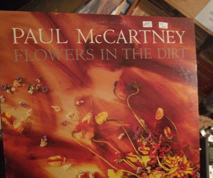 """Closeup of red Paul McCartney record """"Flowers in the Dark"""""""