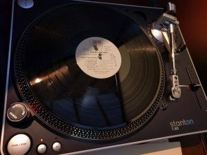 """Record player with record in it reading """"Foxtrot Records""""."""