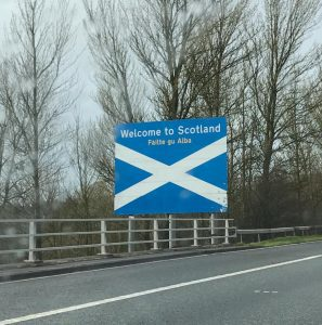 Welcome to Scotland sign with Scottish flag