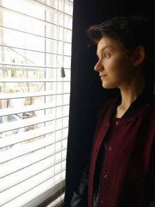 Francesca looking out a window.