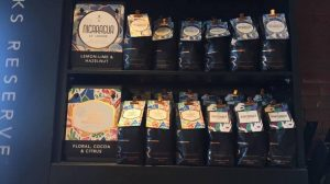 Selection of Starbucks coffee packages on shelf.