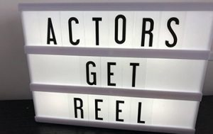 "Lightbox with black letters saying ""Actors Get Reel""."