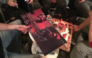 Various band members showing their favourite records.