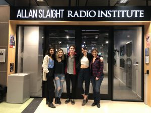 Five people outside Allan Slaight Radio Institute at Ryerson University.