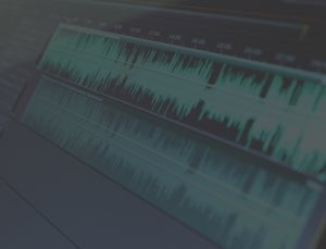 Faded image of green audio waves.