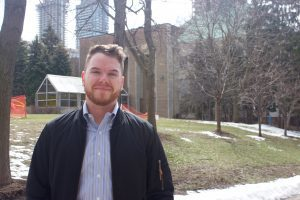 Ryerson professor Sean Hillier standing outside the Quad at Ryerson University.