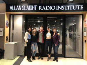 Five people outside Allan Slaight Radio Institute at Ryerson University.