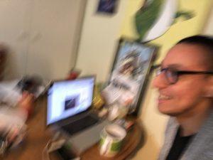 Blurred image of man at computer.