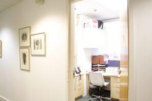 Bright view of empty office looking through doorway.