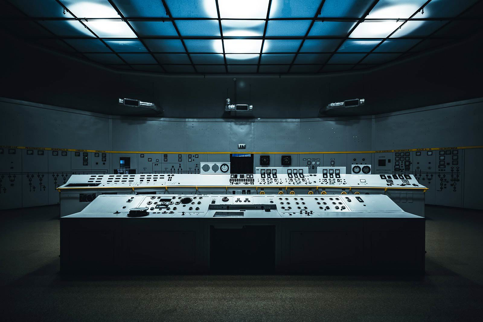 Dark room with with rows of controls.