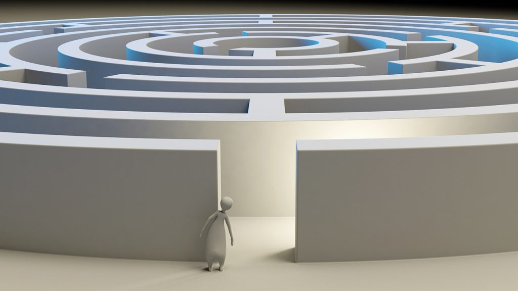 Digital drawing of person peering into large blue and grey maze.