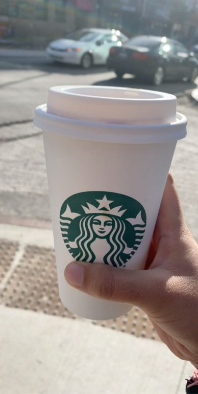 Person holding Starbucks cup.