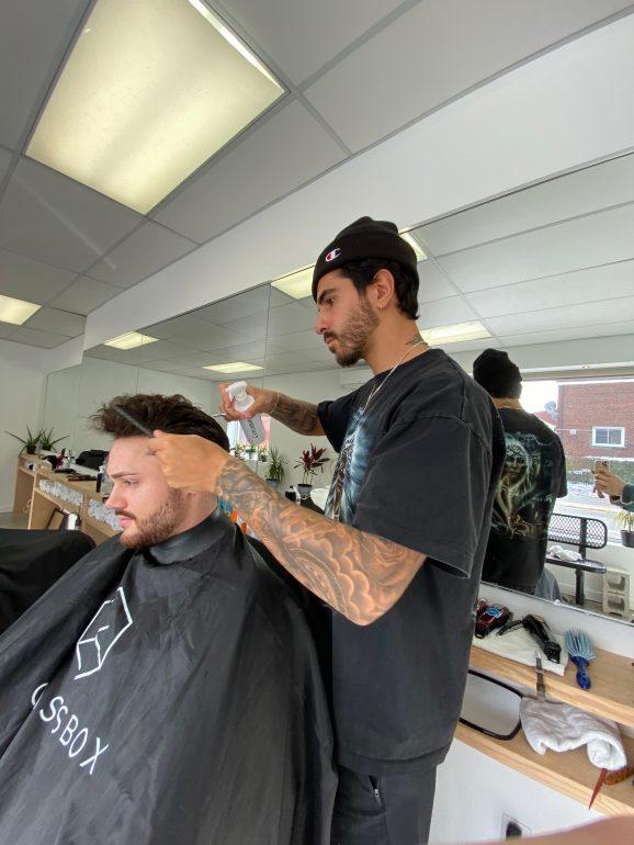 Man cutting client's hair.