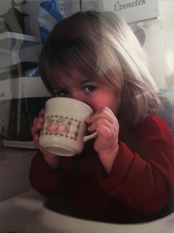 Toddler drinking out of coffee mug