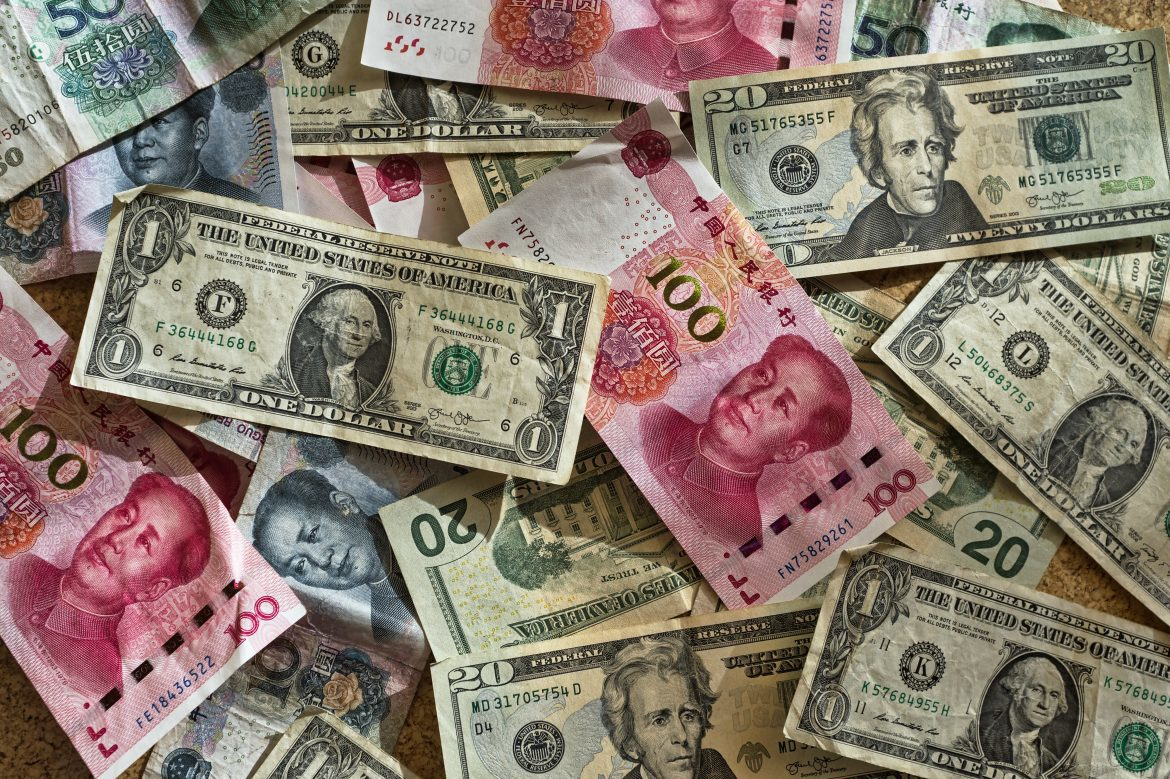 Scattered American and Chinese bills.