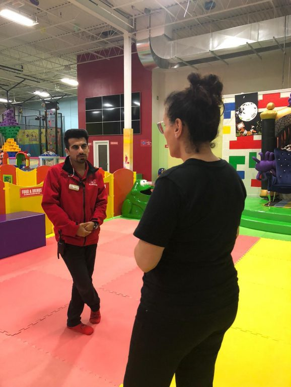 Man and woman talking in play facility.