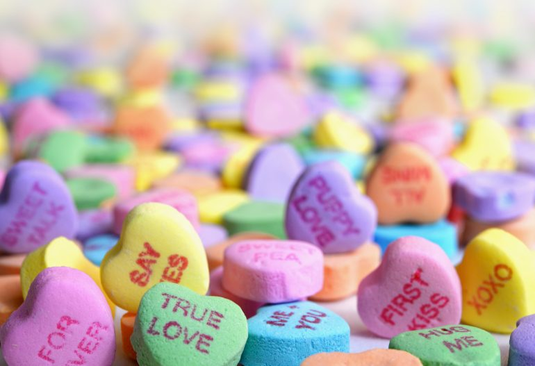 Scattered array of Valentine's heart candy
